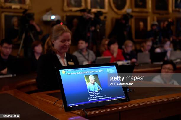 A picture taken on October 9 2017 in Stockholm shows a control screen bearing a portrait of US economist Richard Thaler after he won the Nobel...