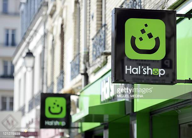 A picture taken on on August 1st in Nanterre a western suburb of Paris shows the logo of a 100% halal food shop the Hal'Shop as the Muslim fasting...