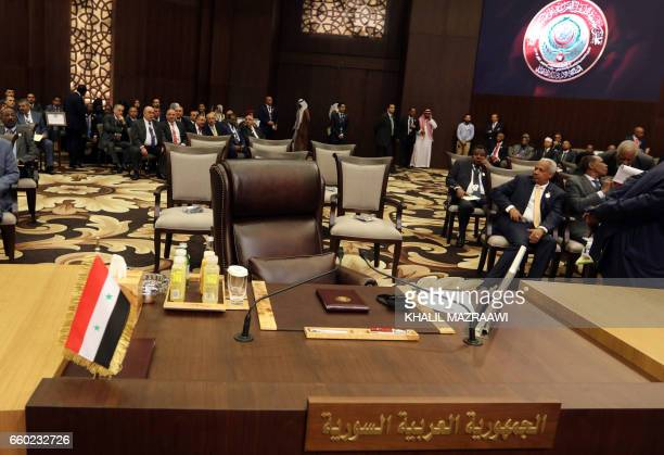 A picture taken on on March 29 shows the empty seat corresponding to the representative of Syria during the Arab League summit in the Jordanian Dead...
