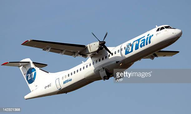 A picture taken on September 10 shows a FrenchItalian made ATR72 passenger plane of private Russian airline UTair board number VPBYZ taking off in...