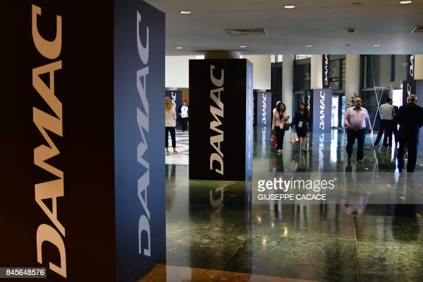 A picture taken on September 11 2017 shows a DAMAC logo on display during the Cityscape Global Dubai's premier property show in Dubai / AFP PHOTO /...