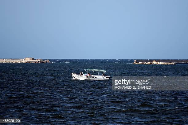 A picture taken on September 12 2015 shows a boat sailing off the coast of the Egyptian port city of Alexandria AFP PHOTO / MOHAMED ELSHAHED