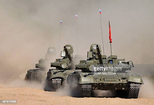 A picture taken on September 12 2015 shows Russian T80 tanks during a performance marking the Tankmen Day at a training ground outside St Petersburg...