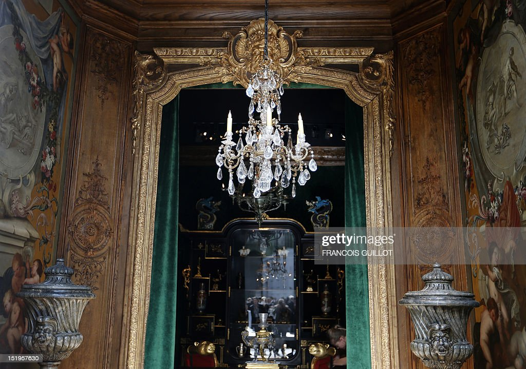 A picture taken on September 13, 2012 shows a chandelier on an exhibition stand during the 26th edition of the 'Biennale des antiquaires' (the antique dealers biennial fair) at the Grand Palais in Paris. The event runs until September 23.