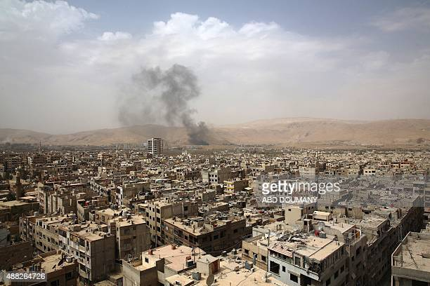 A picture taken on September 14 2015 shows smoke billowing from the Syrian rebelheld area of Douma east of the capital Damascus following a reported...