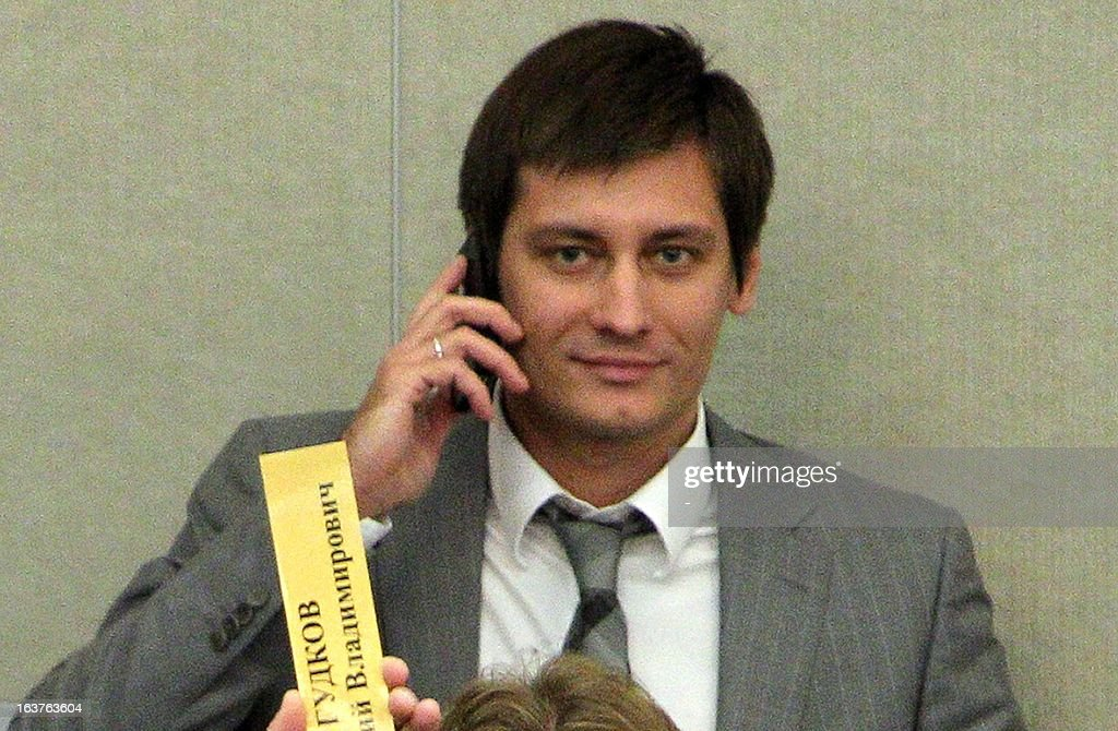 A picture taken on September 14, 2012, shows Dmitry Gudkov, a lawmaker with the opposition A Just Russia party, speaking by his cell phone in Russia's lower house of parliament, the State Duma, in Moscow. Russian lawmakers accused today their fellow deputy Dmitry Gudkov of betraying national interests after he delivered a speech in the United States criticising Vladimir Putin's crackdown on the opposition. Dmitry Gudkov, the son Gennady Gudkov, a vocal member of the anti-Kremlin opposition expelled from the parliament in September over alleged conflicting business interests, travelled to Washington in early March to deliver a speech at a forum organised by a pro-democracy group headed by Pavel Khodorkovsky, the son of the jailed oil tycoon Mikhail Khodorkovsky.