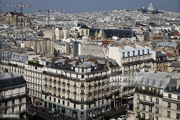 A picture taken on September 15 2014 shows of view of Paris with the Holy Heart basilica AFP PHOTO/JOEL SAGET