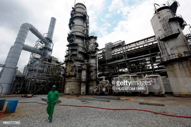 A picture taken on September 16 2015 shows a worker walking past the Port Harcourt's refinery built in 1989 Rivers State The Port Harcourt refinery...