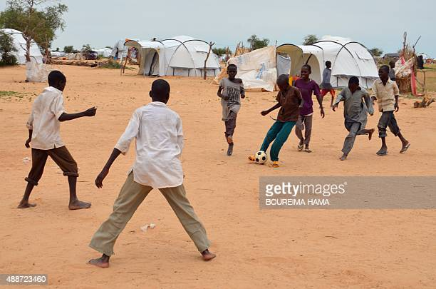 A picture taken on September 16 2015 shows children playing soccer in the Assaga refugee camp set up by the UN three months ago for Nigerian refugees...