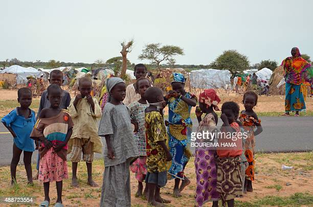 A picture taken on September 16 2015 shows children standing in the Assaga refugee camp set up by the UN three months ago for Nigerian refugees who...