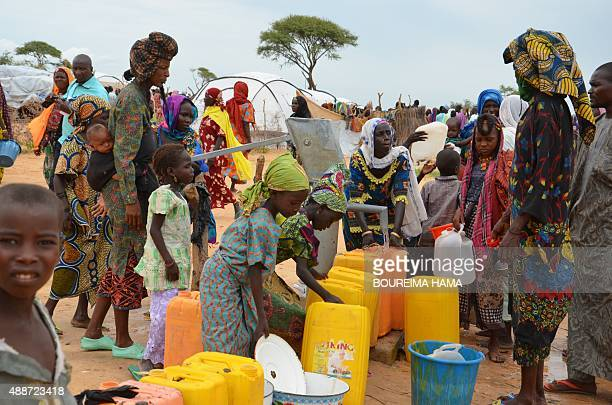 A picture taken on September 16 2015 shows woman looking for drinking water in the Assaga refugee camp set up by the UN three months ago for Nigerian...