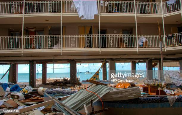 A picture taken on September 16 2017 at Marigot shipyard on the French Caribbean island of Saint Martin shows the Beach Plaza hotel in the Sandy...