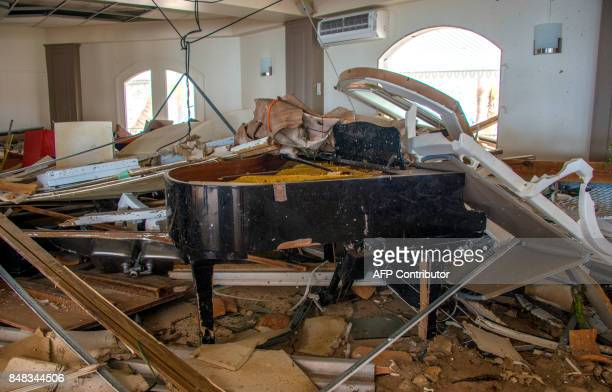 A picture taken on September 16 2017 in the Sandy Ground neighborhood of Marigot shows a broken piano in the Beach Plaza hotel where French gendarmes...