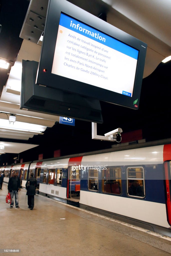 A picture taken on September 17, 2012 shows a RER commuting train stopping on a platform at the Gare du Nord railway station in Paris, after RER commuting trains were blocked for several hours due to an unexpected temporary strike of some SNCF agents.