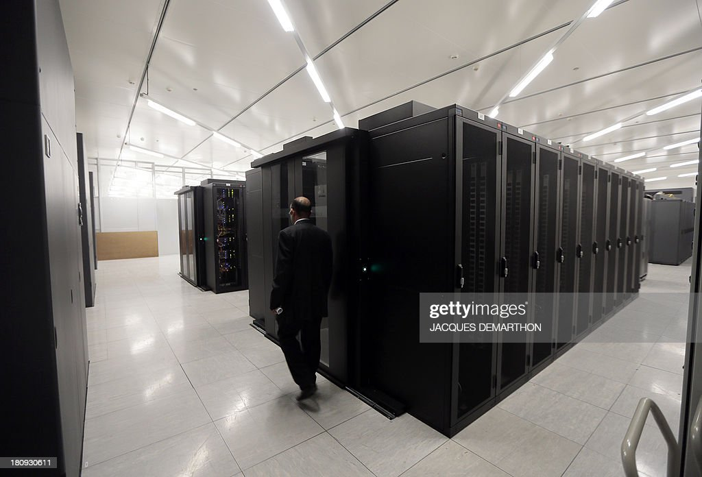 A picture taken on September 17, 2013 in Saint-Denis, outside Paris, shows a room of cabling servers 'clients' at the French branch of Digital Realty, a company involved in datacenter acquisition, ownership, development and operation. Digital Realty's customers include domestic and international companies across multiple industry verticals ranging from information technology and Internet enterprises, to manufacturing and financial services. DEMARTHON