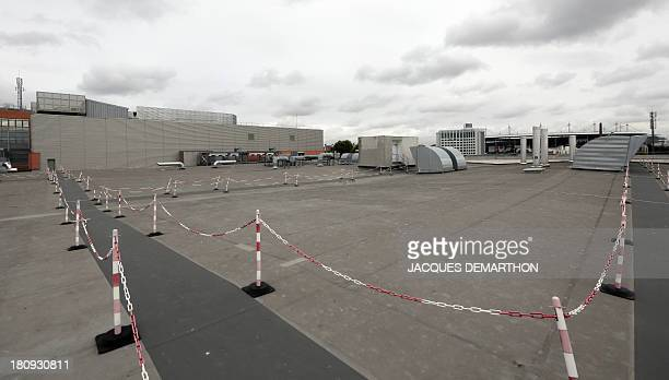 A picture taken on September 17 2013 in SaintDenis outside Paris shows external ventilation and air refrigeration on the roof of the French branch of...