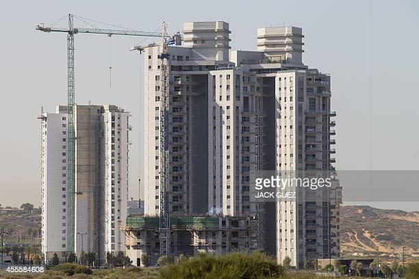 A picture taken on September 17 2014 show new highrise residential apartment buildings under construction in Ramat Poleg a neighbourhood of the...