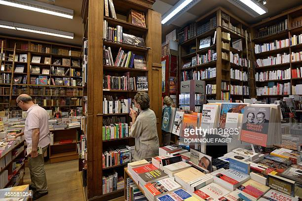 Picture taken on September 17 2014 shows people inside the bookshop Delamain the oldest bookshop of Paris The clients of the oldest bookstore in...