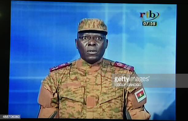 A picture taken on September 17 2015 shows a TV screen during the broadcast of the speech of Lieutenantcolonel Mamadou Bamba announcing that a new...