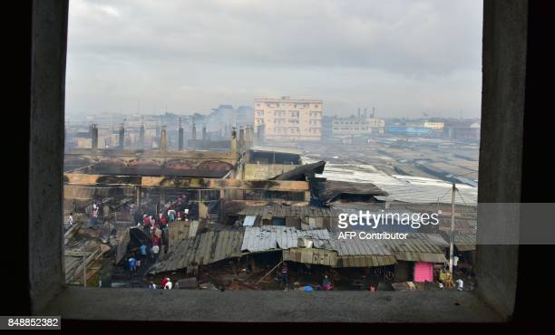 A picture taken on September 18 2017 in Abobo neighborhood of Abidjan shows the market devastated by a fire during the night / AFP PHOTO / ISSOUF...