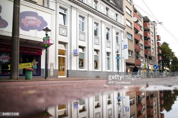 Picture taken on September 18 2017 in Essen western Germany shows the branch of a bank where a 83yearold man had collapsed and hit his head and was...