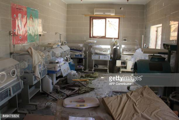 A picture taken on September 19 2017 shows baby incubators at a neonatal intensive care unit covered in rubble and debris following a reported air...