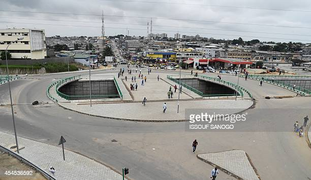 A picture taken on September 2 2014 shows people walking on the Riviera interchange in Abdijan AFP PHOTO / ISSOUF SANOGO