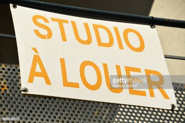 A picture taken on September 20 2017 shows a placard reading ''Studio for rent' on the facade of a student residence in the French southwestern city...