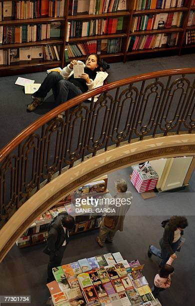 Picture taken on September 2007 showing a young woman reading books at the first level of El Ateneo bookstore in the Barrio Norte neighborhood in...