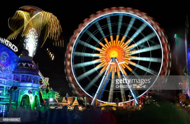 A picture taken on September 21 2015 shows a ferris wheel at the Theresienwiese fair grounds of the Oktoberfest beer festival in Munich The World's...
