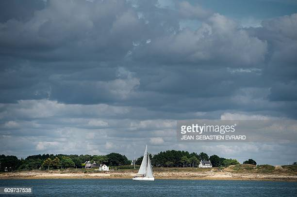 A picture taken on September 22 2016 shows a boat sailing off La TrinitesurMer western France / AFP PHOTO / JEANSEBASTIEN EVRARD