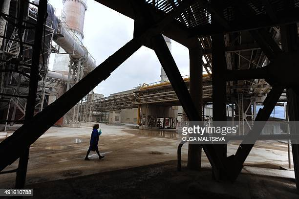 MOYON* A picture taken on September 23 2015 shows an employee walking at the BaselCement factory in the town of Pikalevo some 260 km of St Petersburg...