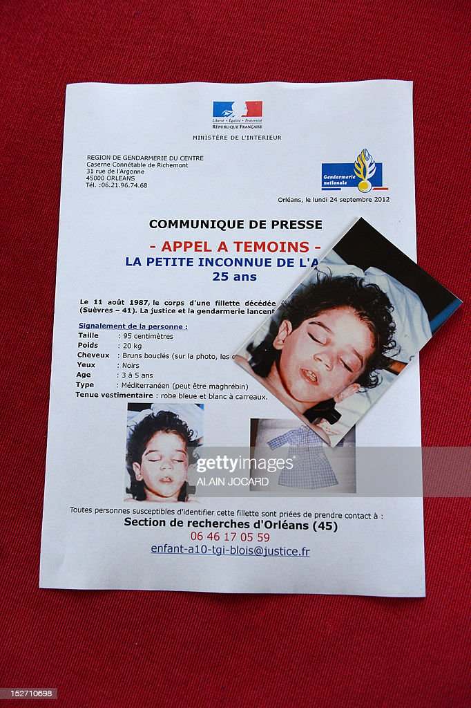 A picture taken on September 24, 2012 in Blois shows an appeal for witnesses and a picture during a press conference of Blois' prosecutor who announced that she reopens the case of an unidentified three or four-year-old girl found dead on August 11, 1987 on the motor highway A10, near Blois.