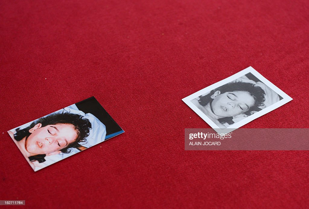 A picture taken on September 24, 2012 in Blois shows pictures presented to journalists during a press conference of Blois' prosecutor who announced that she reopens the case of an unidentified three or four-year-old girl found dead on August 11, 1987 on the motor highway A10, near Blois.