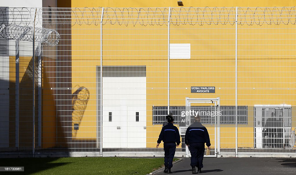 A picture taken on September 24, 2013 shows guards walking in the Centre Penitentiaire Sud-Francilien prison in Reau, outside Paris.
