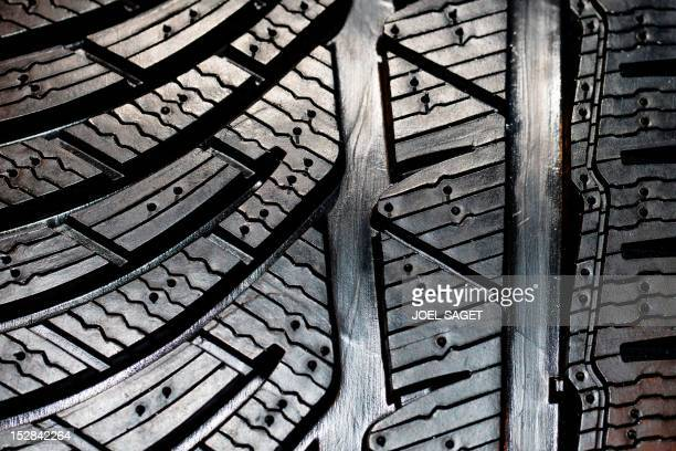 A picture taken on September 27 2012 shows a tyre Michelin during the press days ahead of the opening of the Paris Motor Show at the Porte de...
