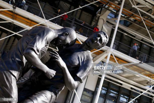 A picture taken on September 28 2012 in Paris shows a bronze sculpture by French Algerian born artist Adel Abdessemed displayed in front of the...