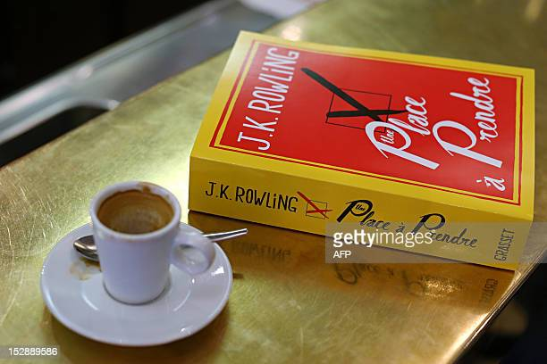 A picture taken on September 28 2012 in Paris shows a copy of 'The Casual Vacancy' the new novel by British author JK Rowling as it goes on sale for...