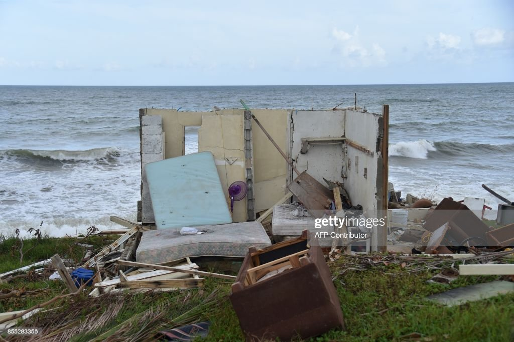 A picture taken on September 28, 2017 shows a house destroyed by Hurricane Maria in Yabucoa, in the eastern part of storm-battered Puerto Rico. A week after the Category Four storm stuck, the White House said US President Donald Trump had made it easier for fuel and water supplies to arrive to the ravaged island of 3.4 million US citizens. /