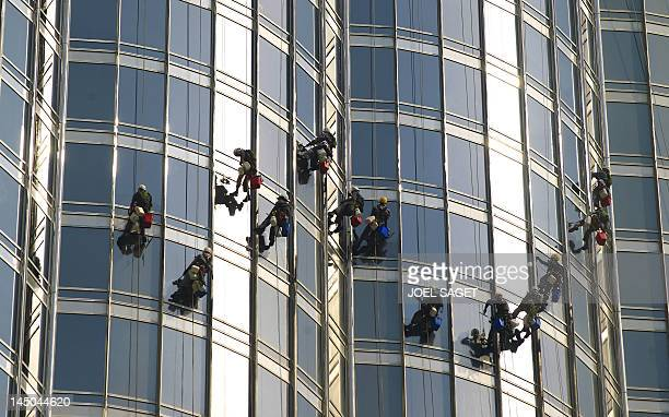 A Picture taken on September 29 2010 shows workers cleaning the windows of the Dubai's Burj Khalifa building the world's tallest tower AFP PHOTO /...