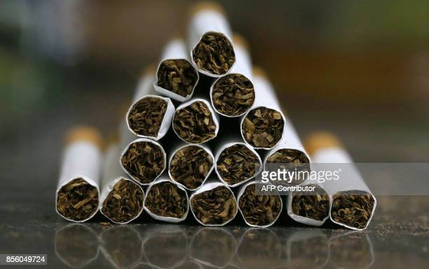 A picture taken on September 29 2017 shows a close up shot a stack of cigarettes in Kuwait City On October 1 the United Arab Emirates will double the...