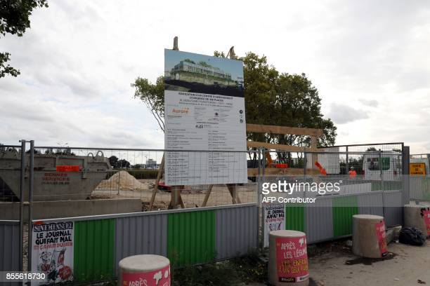 A picture taken on September 29 2017 shows a panel bearing instructions regarding the construction of the accommodation centre for homeless people at...
