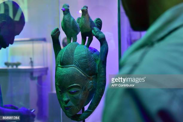 A picture taken on September 29 2017 shows a statue exhibited at the Civilisation Museum of Abidjan as part of the first exhibition called...
