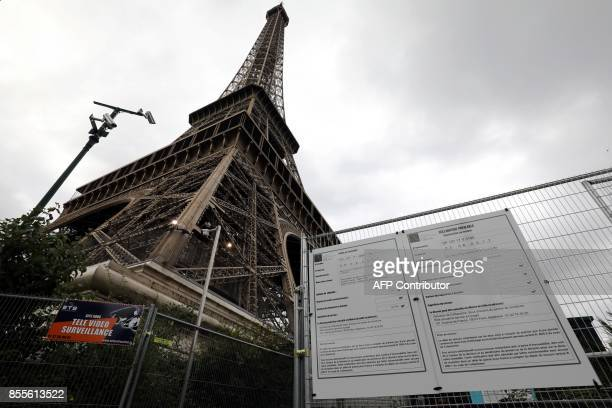 A picture taken on September 29 2017 shows on a metal gate a panel bearing instructions regarding the construction of bulletproof glass walls set to...