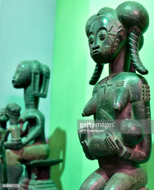 A picture taken on September 29 2017 shows statues exhibited at the Civilisation Museum of Abidjan as part of the first exhibition called...