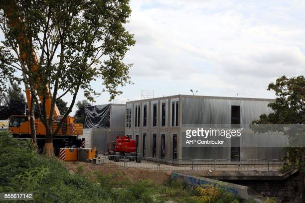 A picture taken on September 29 2017 shows the underconstruction building that will host an accommodation centre for homeless people at Porte de...