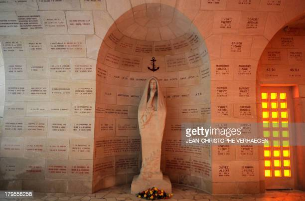 A picture taken on September 3 2013 shows a statue in the cloister of the ossuary of Douaumont in Douaumont eastern France The ossuary is a memorial...
