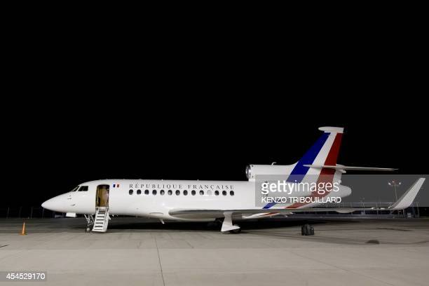 A picture taken on September 3 2014 at Villacoublay's airport in VelizyVillacoublay near Paris shows a French Dassault planemaker Falcon 7X plane...