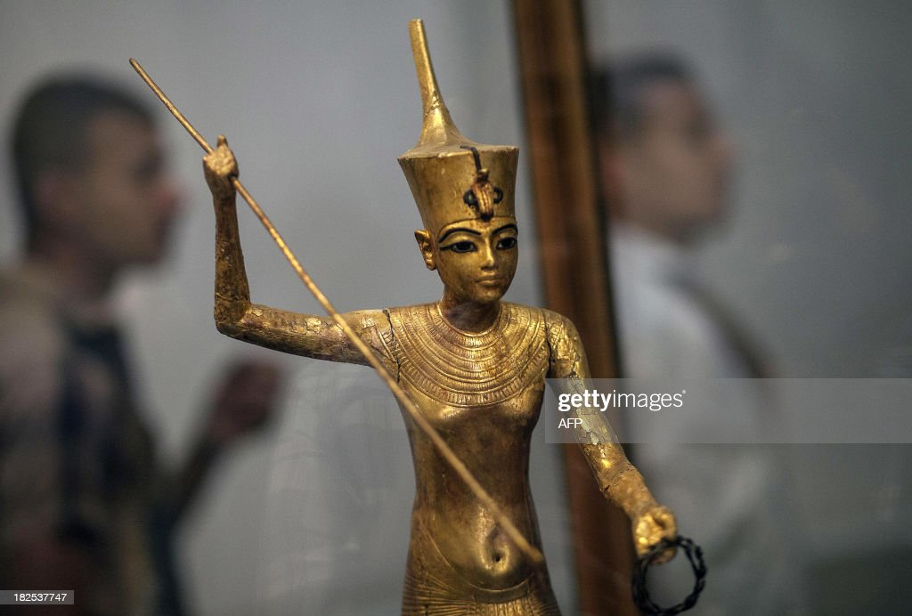 A picture taken on September 30, 2013 shows a statue of the 18th Dynasty king Tutankhamun standing on a papyrus boat displayed at the Egyptian Museum in Cairo. The statue had been stolen along with three other Pharaonic artefacts from the Egyptian Museum in January 2011 during the first days of the revolution that toppled president Hosni Mubarak and then found in a bag at a Metro station in the Egyptian capital.