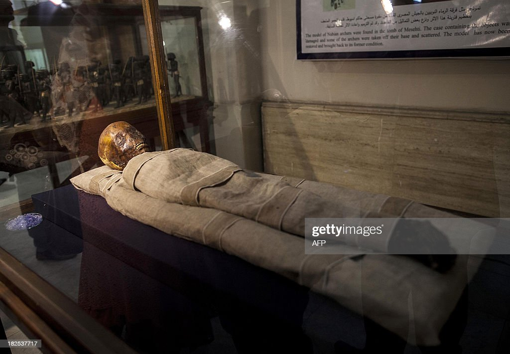 A picture taken on September 30, 2013 shows the mummy of a child called Amenhotep displayed at the Egyptian Museum in Cairo. The mummy was severely damaged in January 2011 during the first days of the revolution that toppled president Hosni Mubarak.